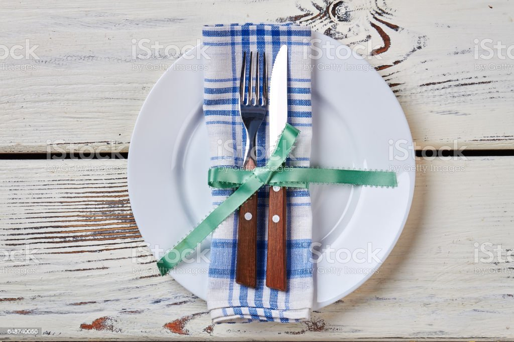 Plate with napkin and cutlery. stock photo