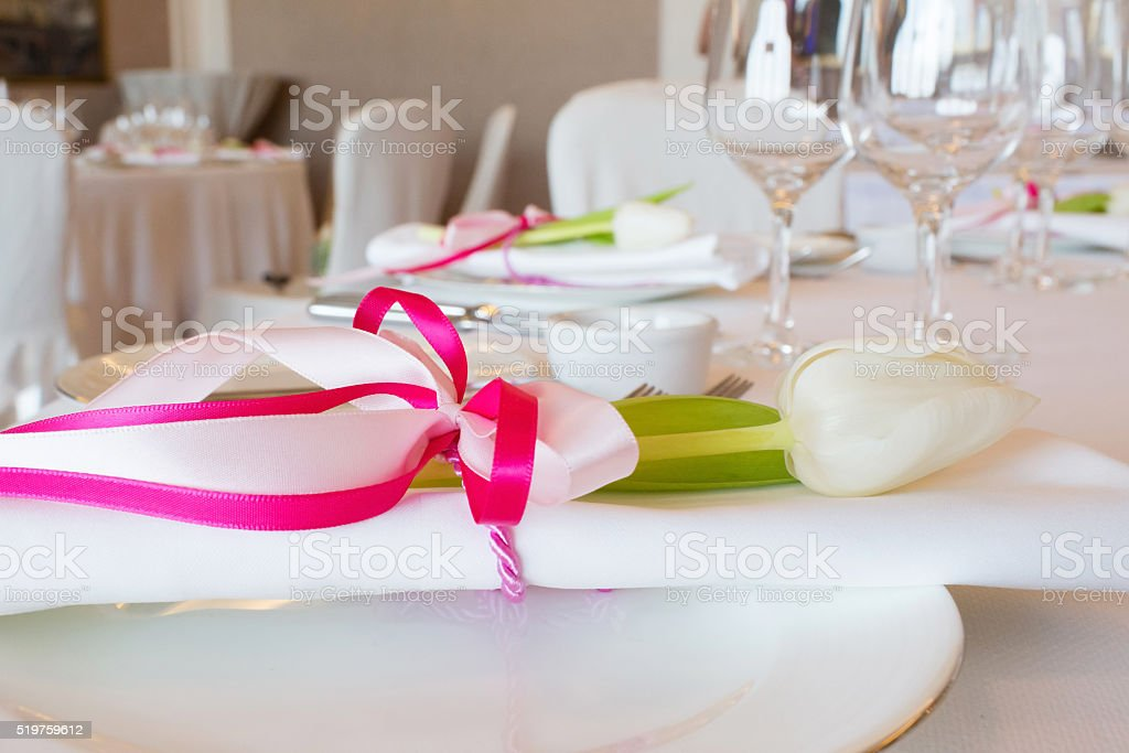 Plate with napkin with pink ribbon stock photo