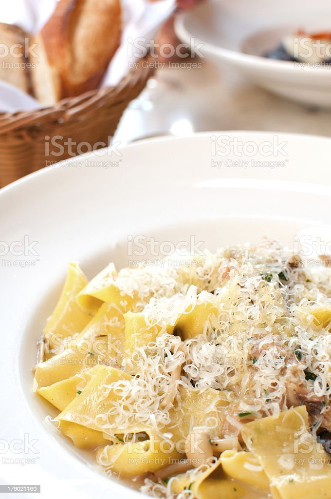 Plate with pappardelle pasta and porcini mushrooms stock photo