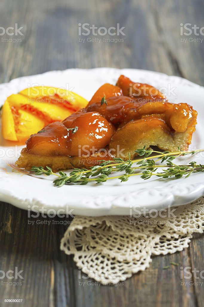 Plate with peach pie and thyme. stock photo