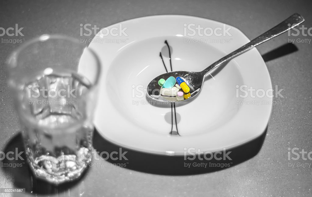 Plate with pills and watter stock photo