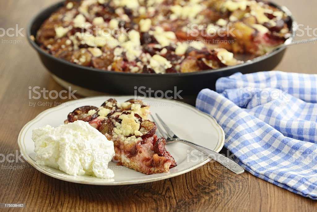 plate with plum cake of crumpet and whipped cream stock photo