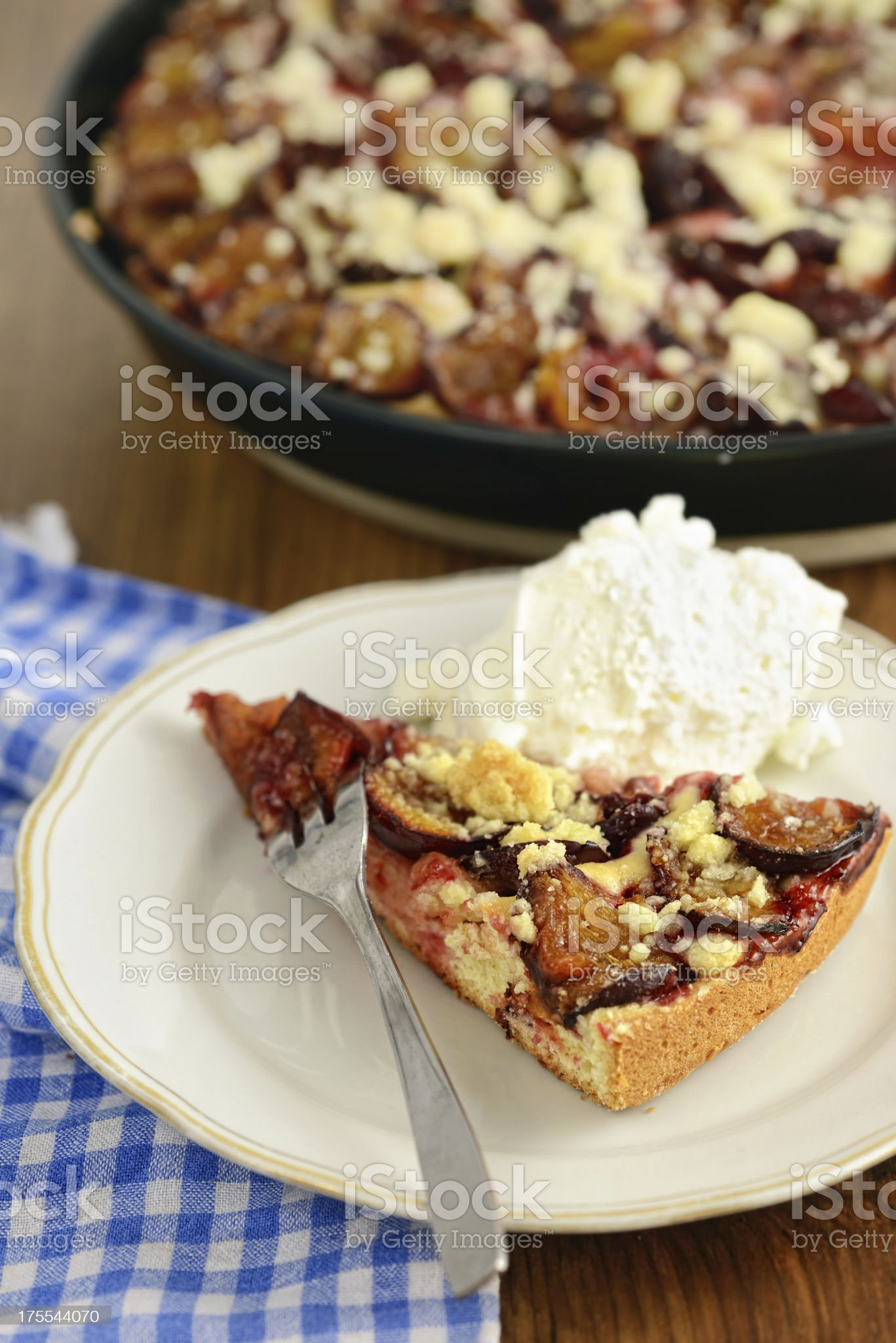 plate with plum cake of crumpet and whipped cream royalty-free stock photo
