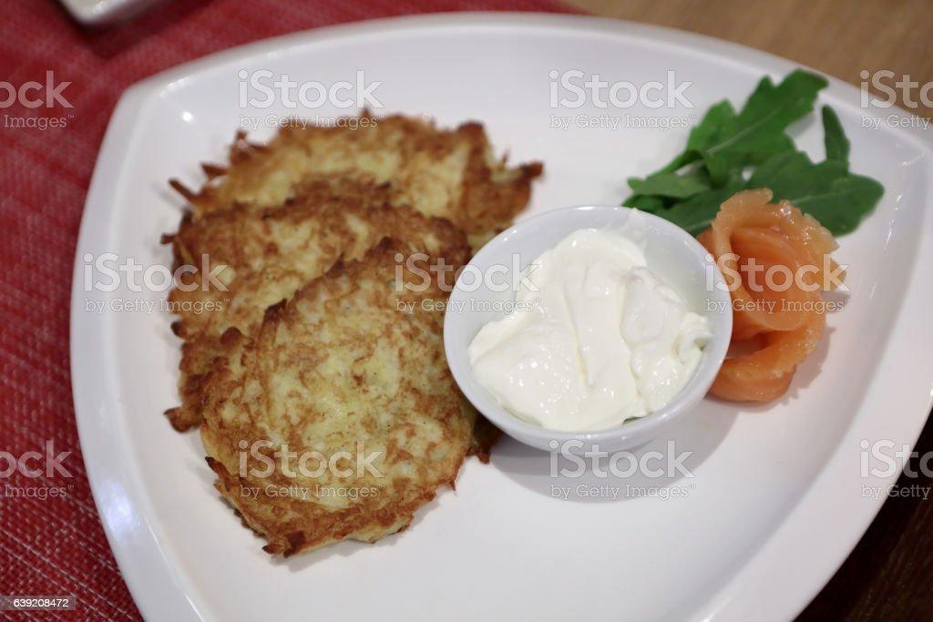 Plate with potato pancakes stock photo