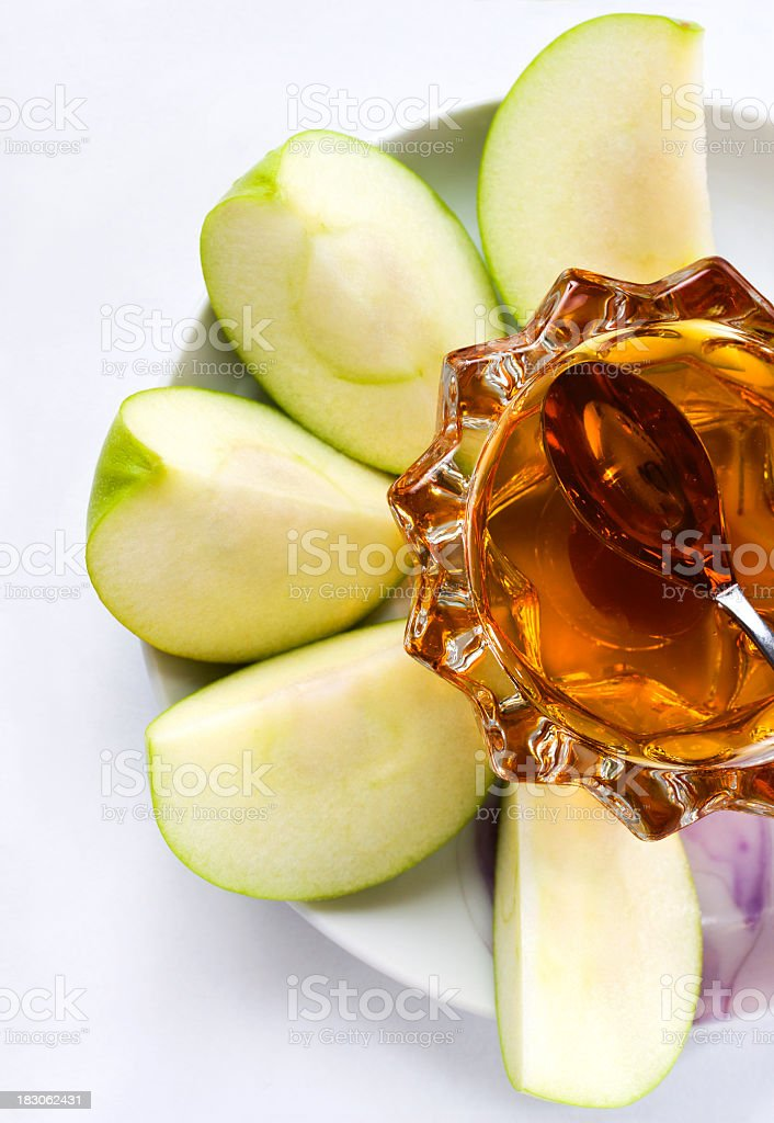 A plate with sliced apples and honey on it  stock photo