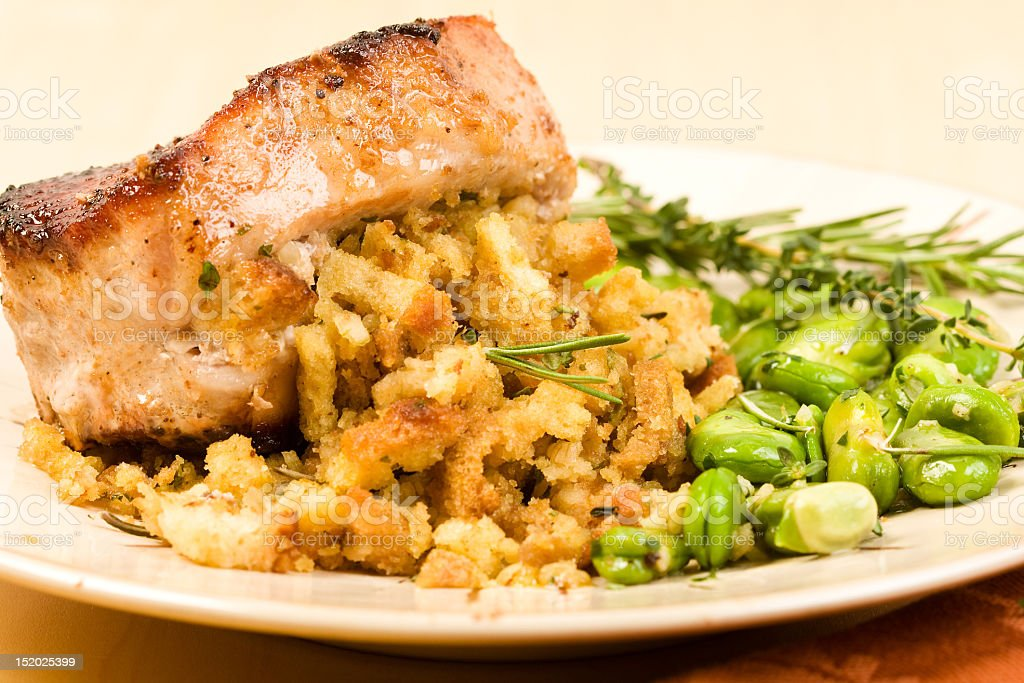 A plate with stuffed pork chop on a white plate stock photo