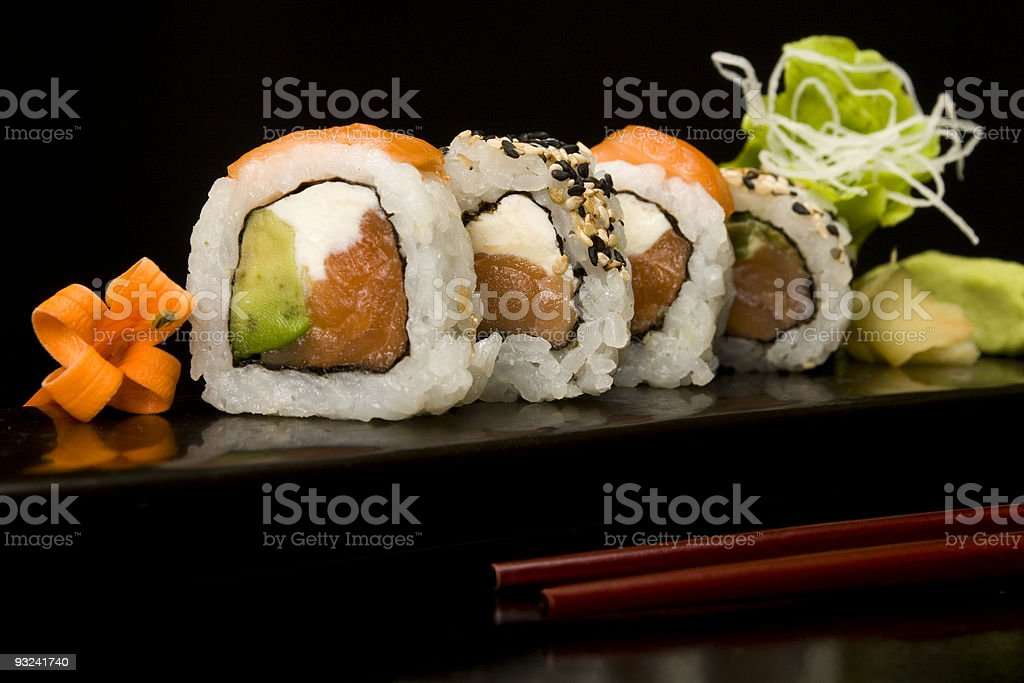 A plate with sushi and garnish stock photo