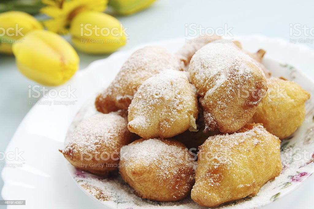 Plate with sweet donut holes with sprinkled sugar stock photo