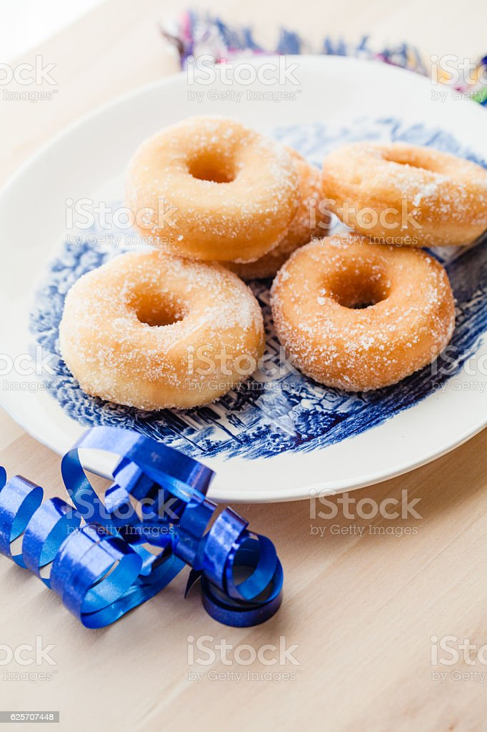 Plate with sweet donuts with sprinkled sugar stock photo