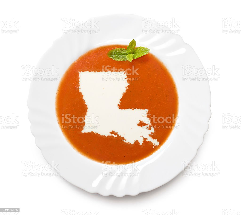 Plate with tomatosoup and cream (shape of Louisiana) stock photo