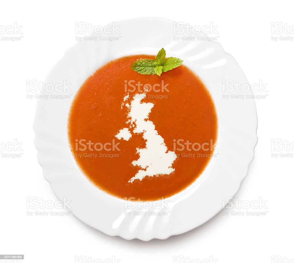 Plate with tomatosoup and cream (shape of United Kingdom) stock photo