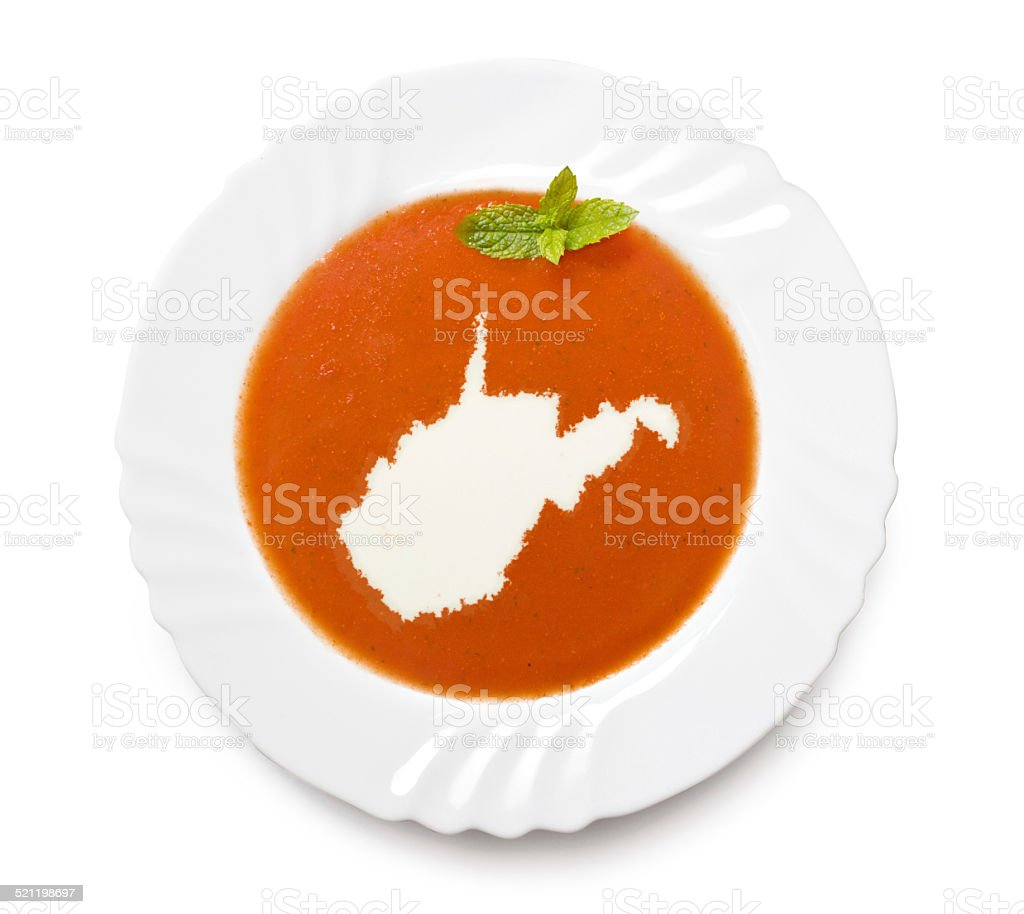 Plate with tomatosoup and cream (shape of West Virginia) stock photo