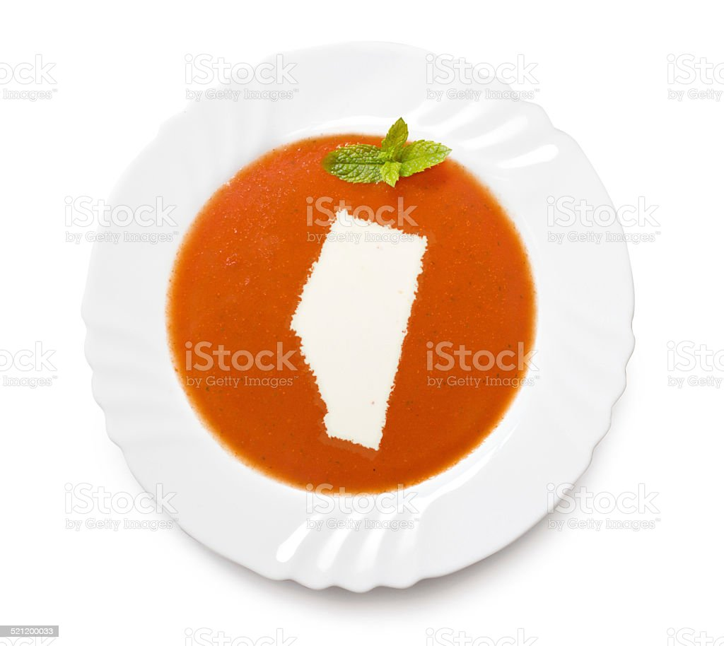 Plate with tomatosoup and cream (shape of Alberta) stock photo