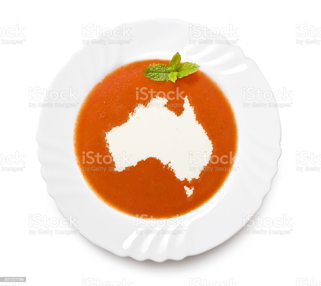 Plate with tomatosoup and cream (shape of Australia) stock photo
