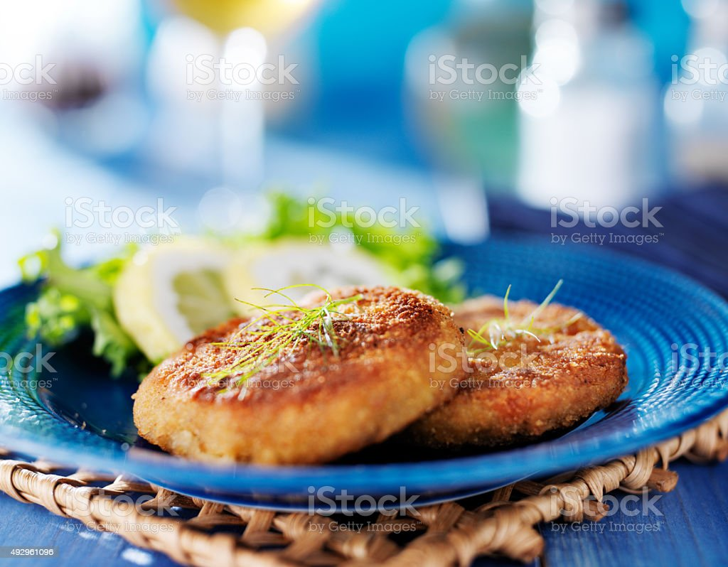 plate with two golden fried maryland crabcakes stock photo