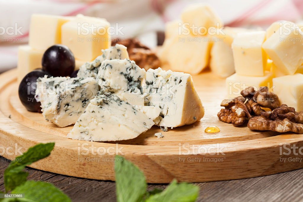Plate with various cheeses stock photo