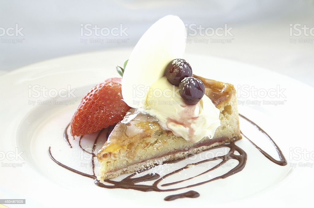 plated bakewell tart stock photo
