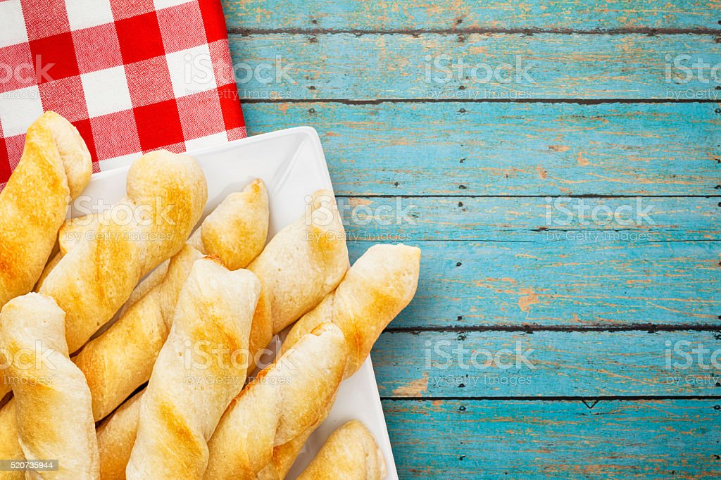 Plated Breadsticks on Wood Background with Napkin stock photo