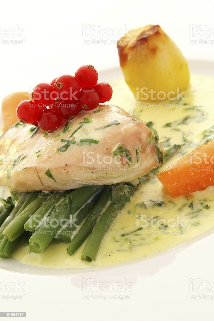 plated chicken dinner with  vegetables stock photo