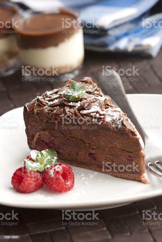 Plated chocolate dessert with fresh raspberries stock photo