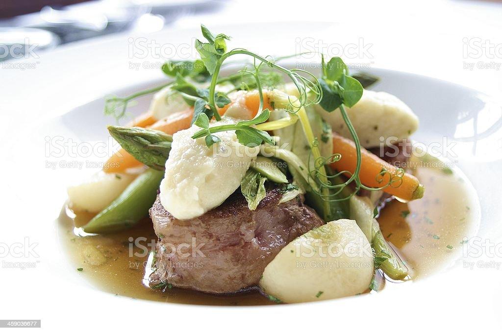 plated lamb dish with seasonal vegetables stock photo