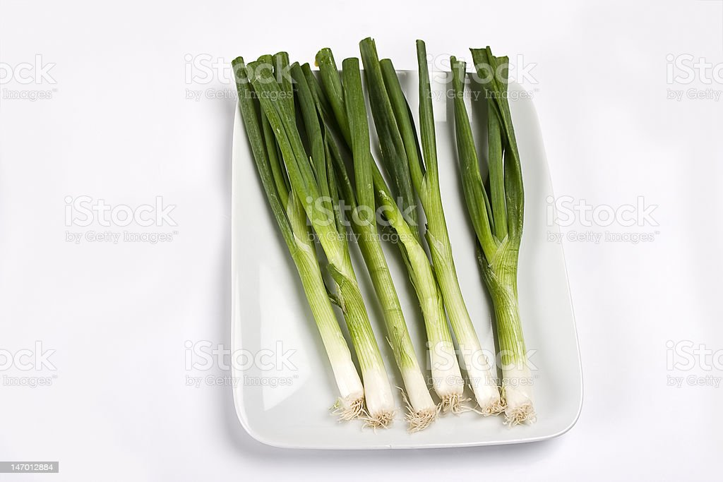Plateful of Spring onions royalty-free stock photo