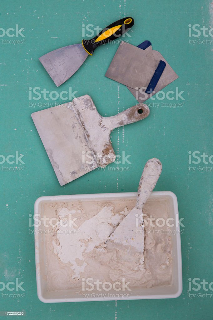 Platering tools for plaster like plaste trowel spatula stock photo