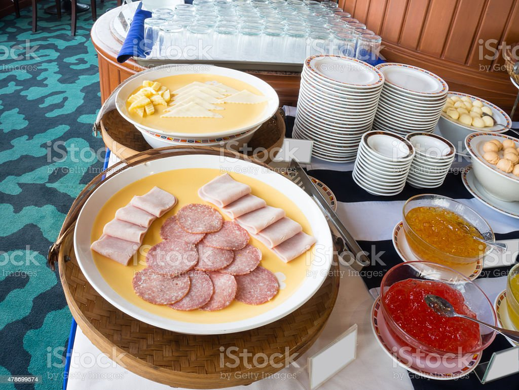Plates of cold cuts and cheese at a hotel buffet stock photo
