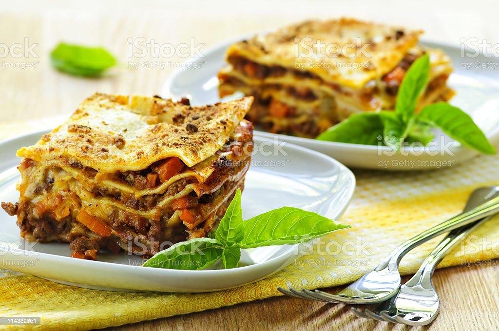 Plates of lasagna stock photo