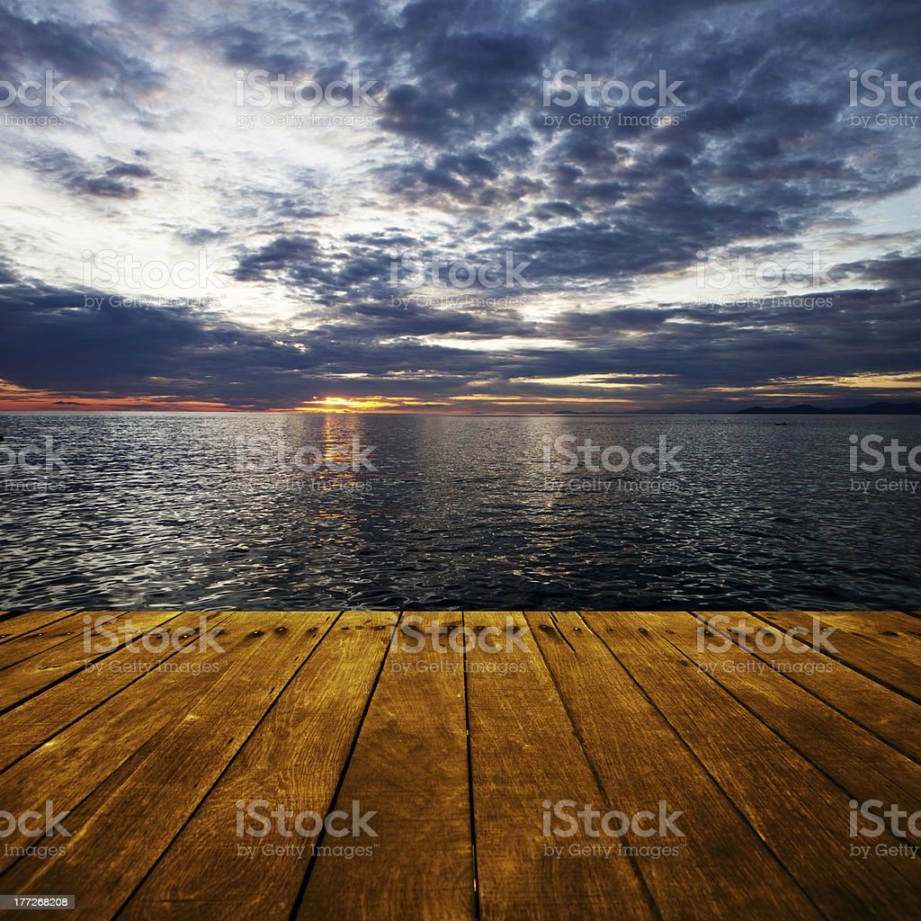 platform beside sea with sunset stock photo