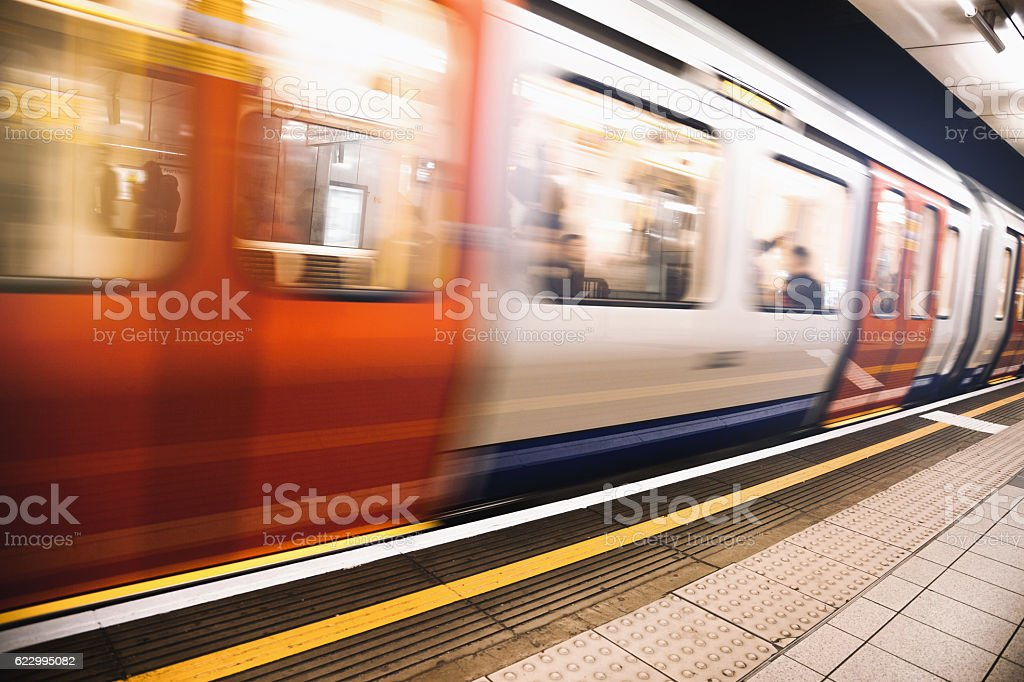 Platform of the London Underground with train approaching stock photo