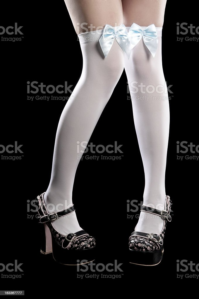 Platform shoes and over-the-knee stockings. stock photo