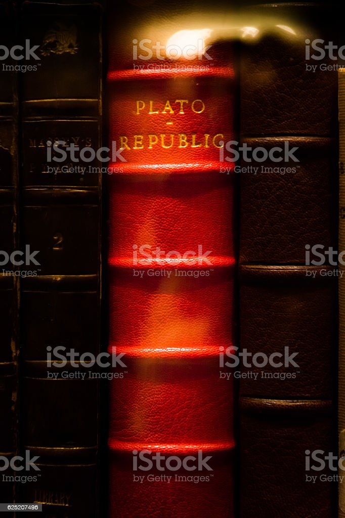 Plato Republic Leather Bound Book Bright Red Library Glass Case stock photo