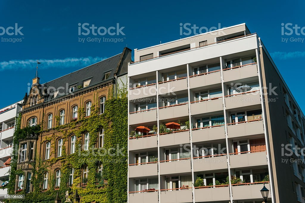 plattenbau building next to old fashioned building stock photo