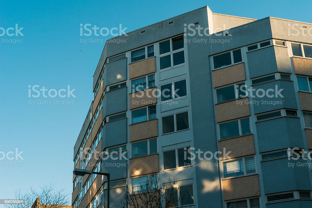 plattenbau building with light reflections on the facade stock photo