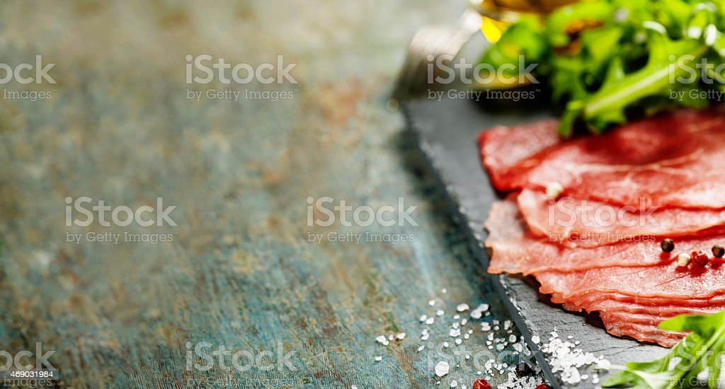 A platter of food known as Beef Carpaccio  stock photo