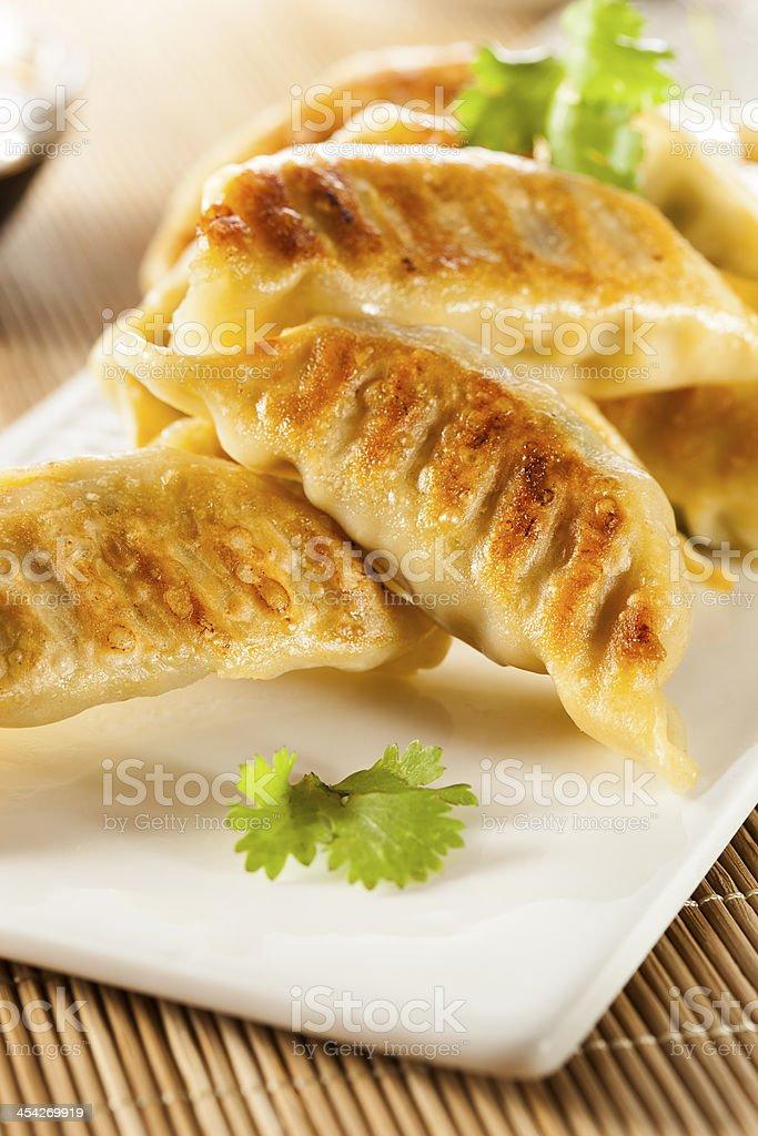 A platter of homemade asian vegetarian potstickers stock photo