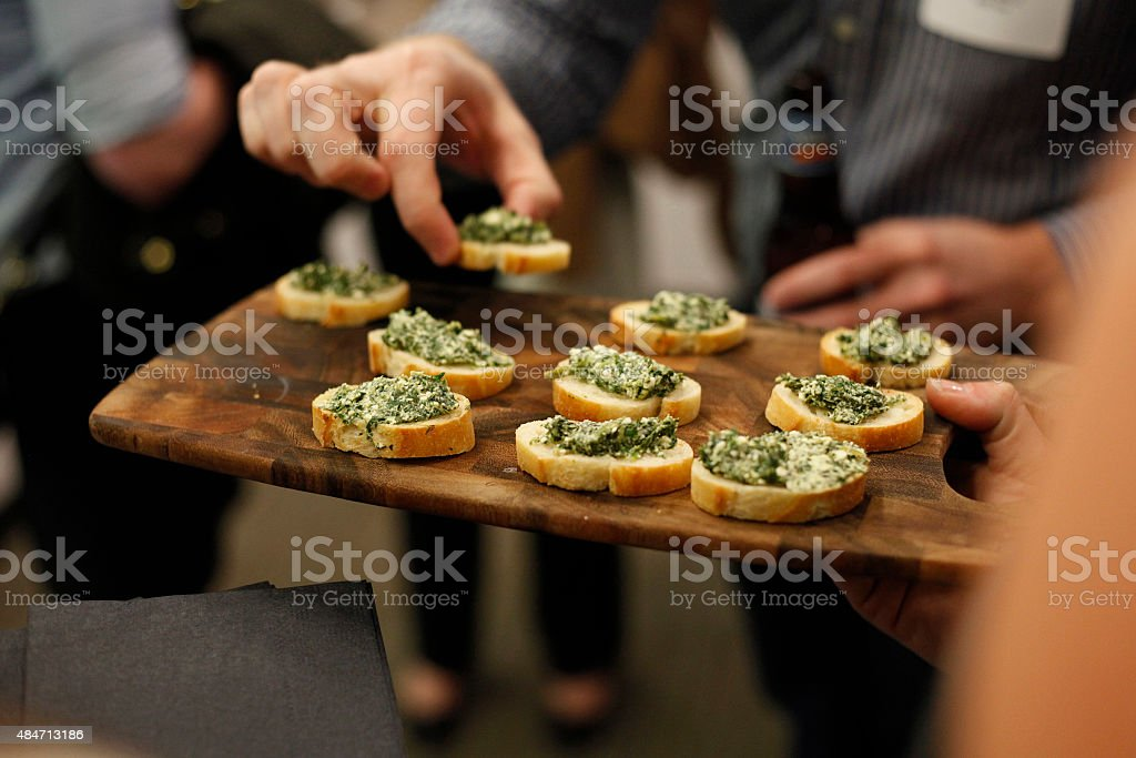 Platter of spinach and artichoke dip served at a party stock photo
