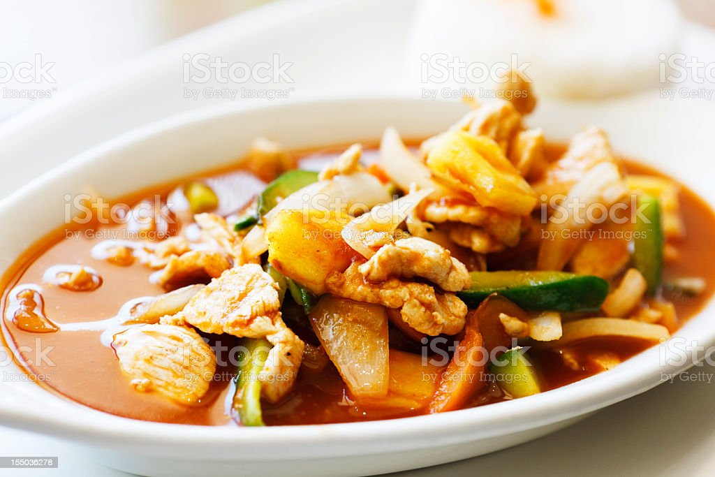 Platter of Thai-style sweet and sour chicken with rice royalty-free stock photo