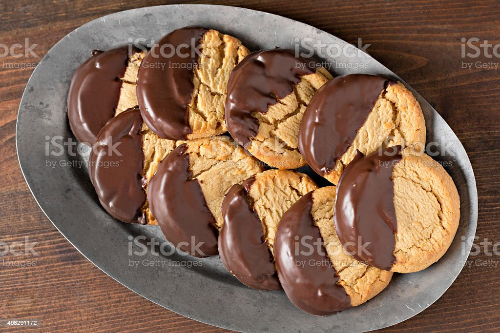 Platter With Chocolate Dipped Peanut Butter Cookies stock photo