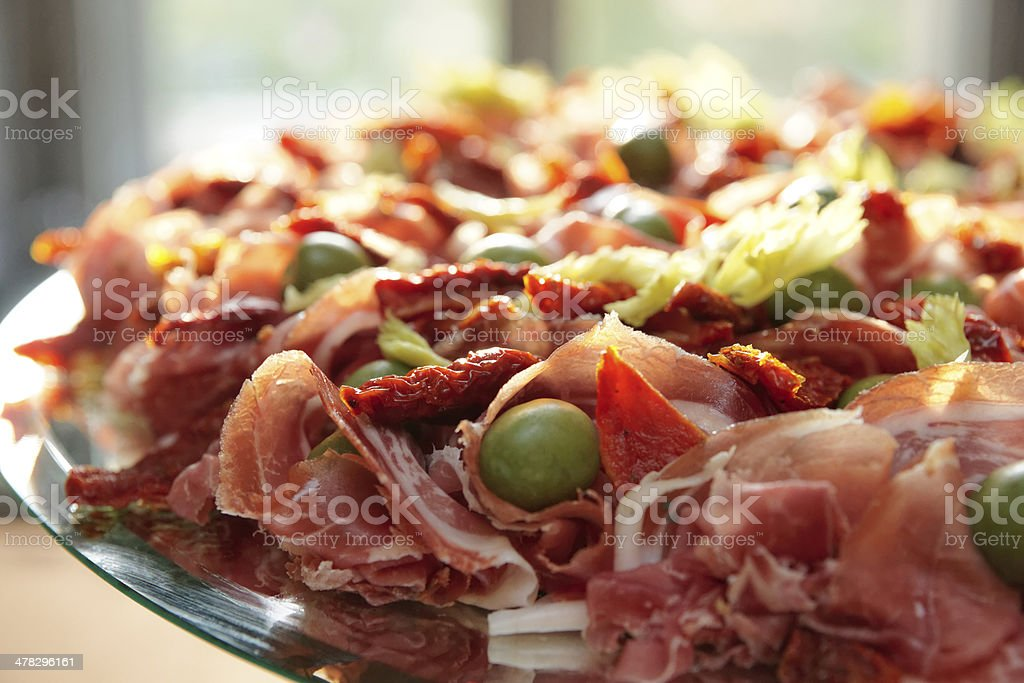 Platter with cured ham on table stock photo
