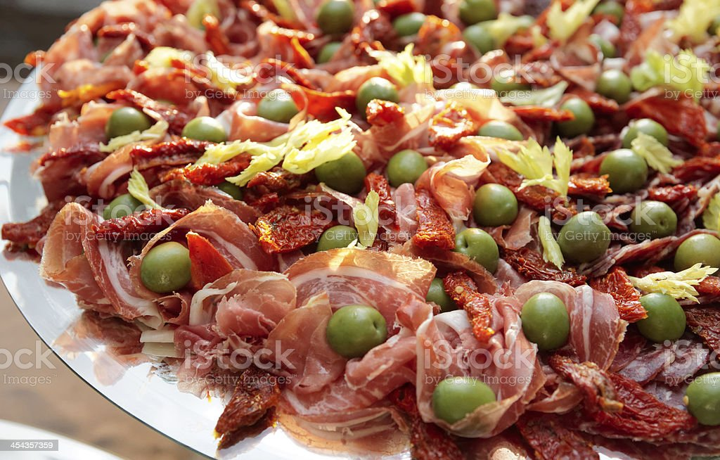 Platter with cured ham stock photo