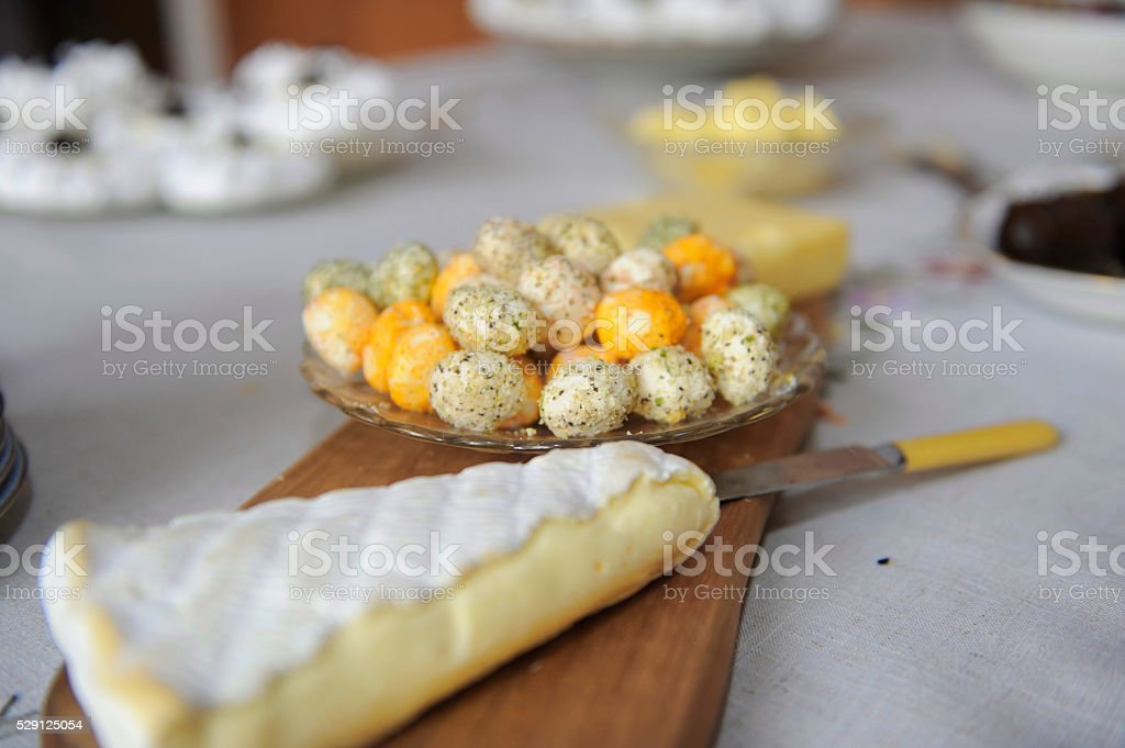Platter with vaious cheeses and a cheese knife stock photo