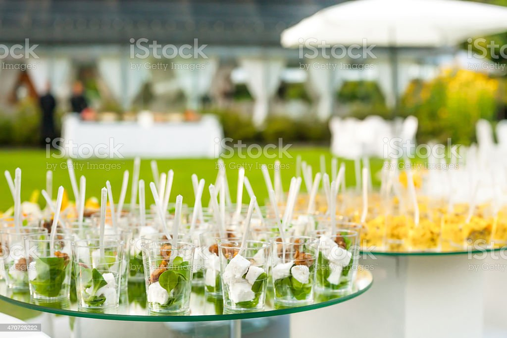 Platters of Canapes and Appetizers on glass tables stock photo