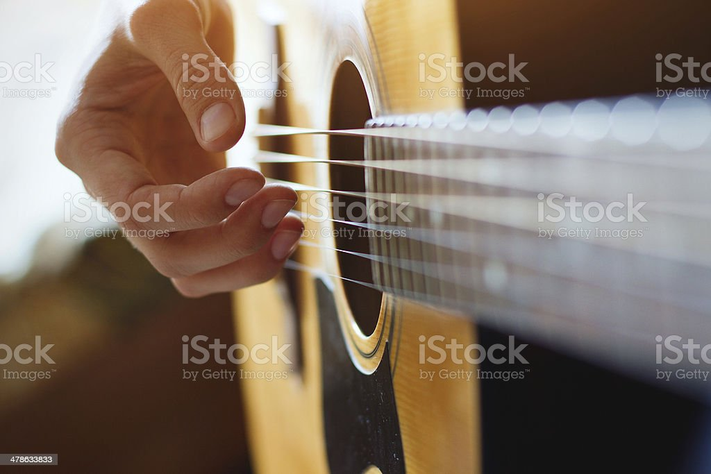 play acoustic guitar stock photo