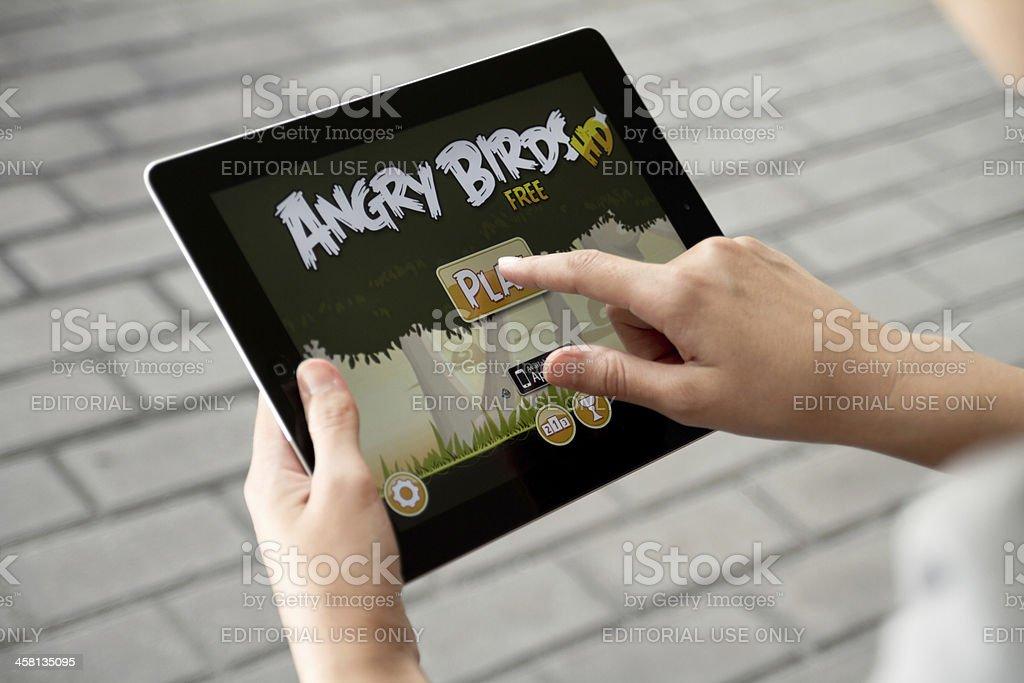 Play Angry Birds on Apple Ipad2 royalty-free stock photo