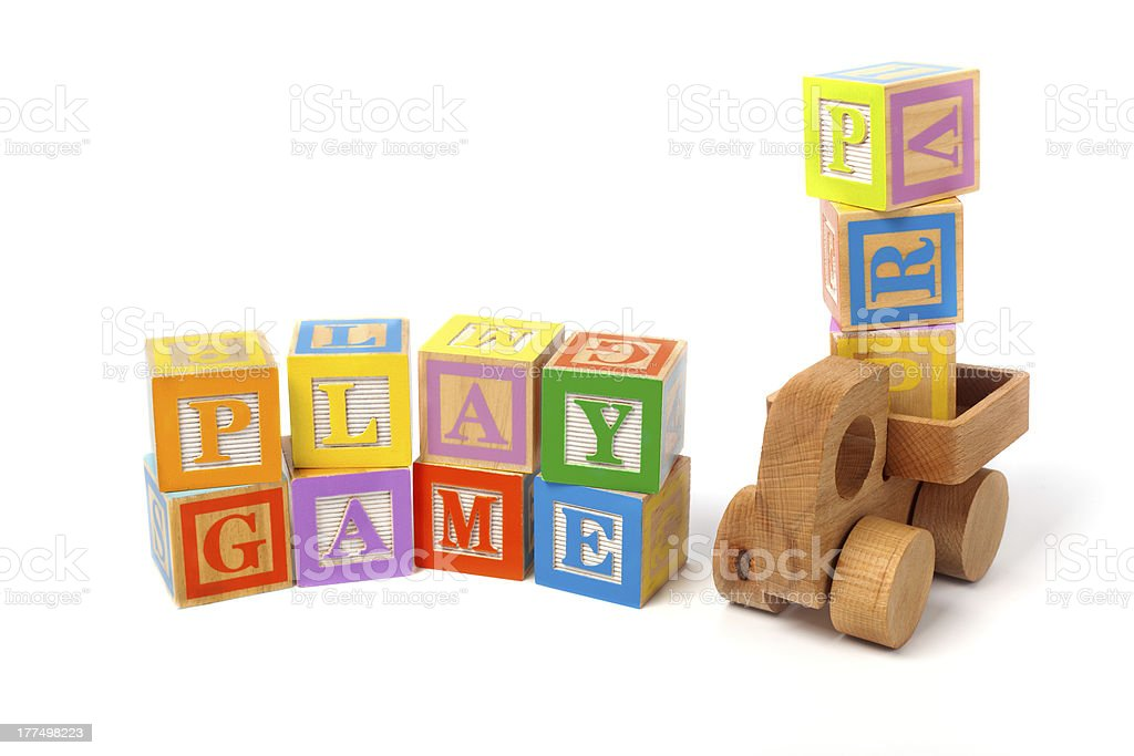 play blocks and wooden toy truck on white background stock photo