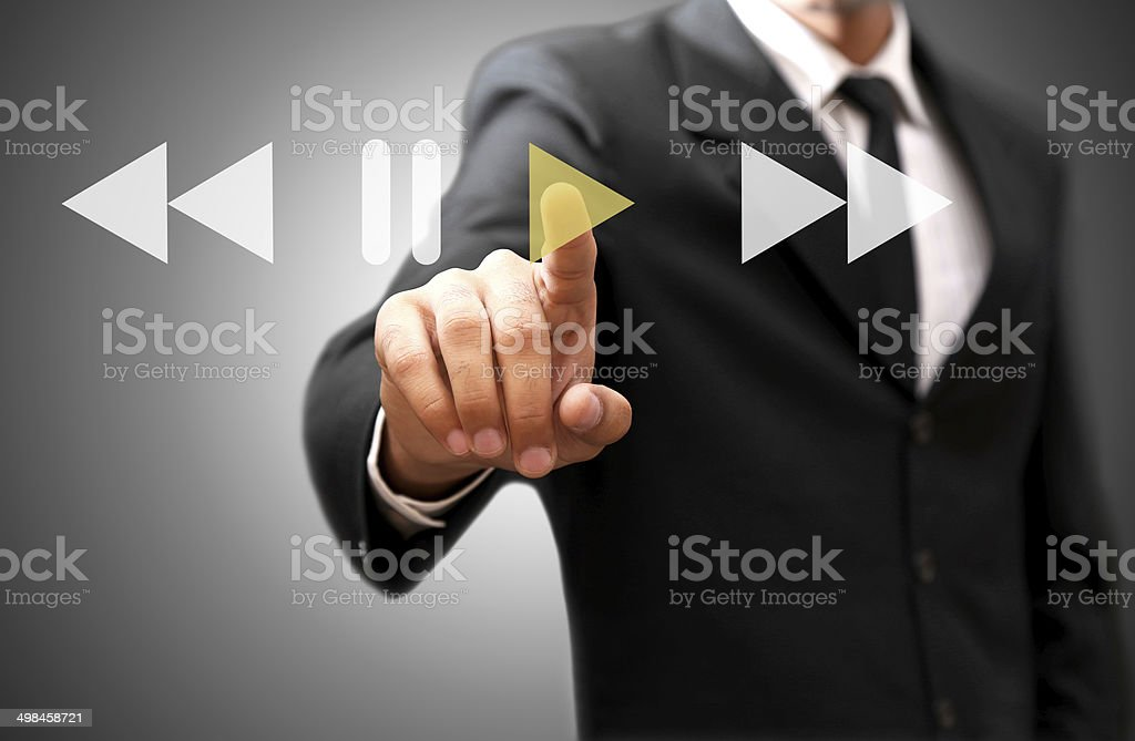 Play button on virtual screen stock photo