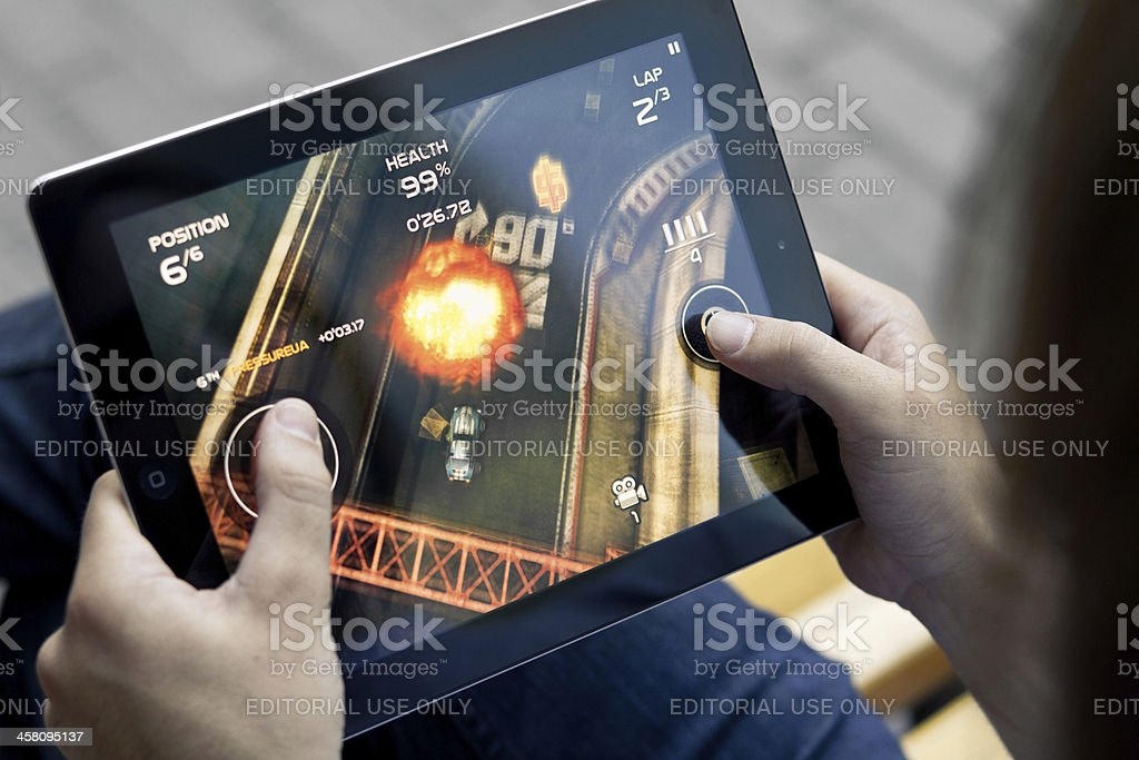 Play Death Rally on Apple Ipad2 stock photo