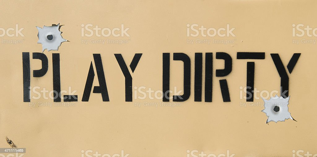 Play Dirty Sign with Bullet Holes royalty-free stock photo
